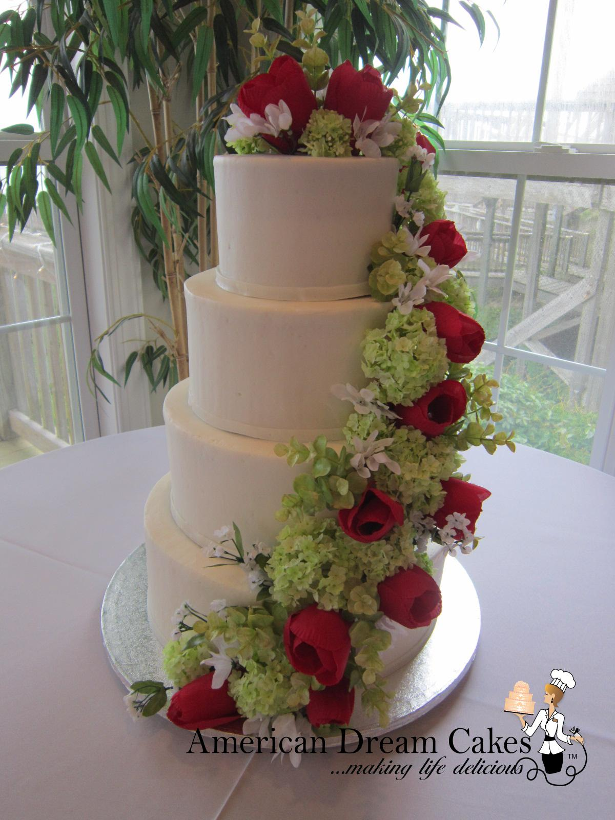 Boho white wedding cake with cascading flowers