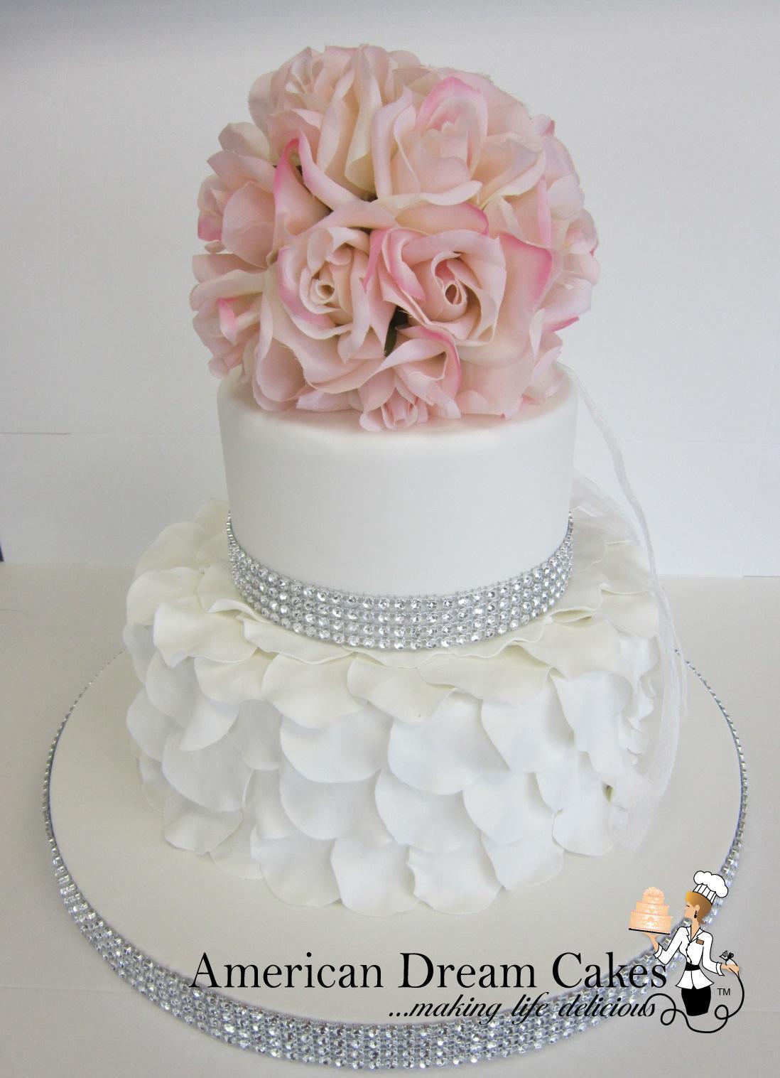 Romantic white wedding cake with petals ruffles
