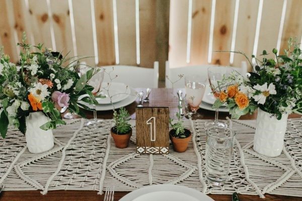 Boho wedding table setting with Bohemian flower arrangements and succulent plants