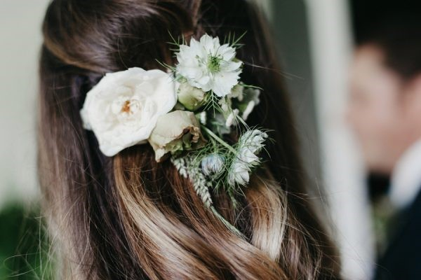 Boho wedding hairstyle with flower aand rustic elements