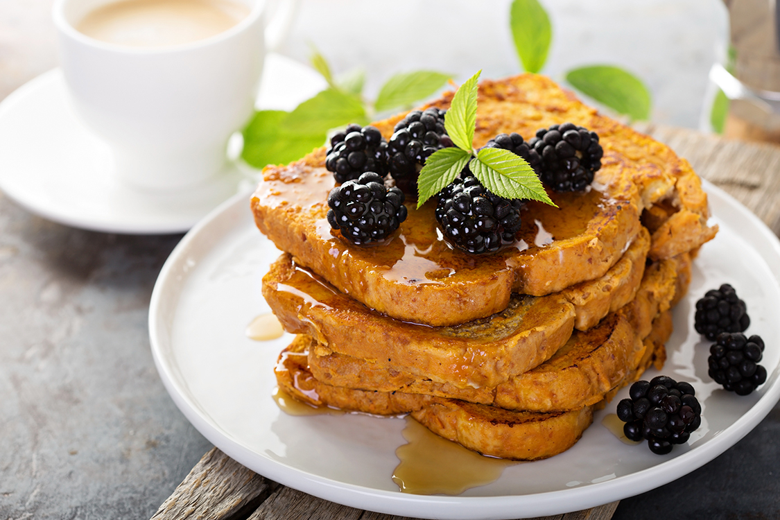 Pumpkin french toast with berries aand maple syrup for breakfast