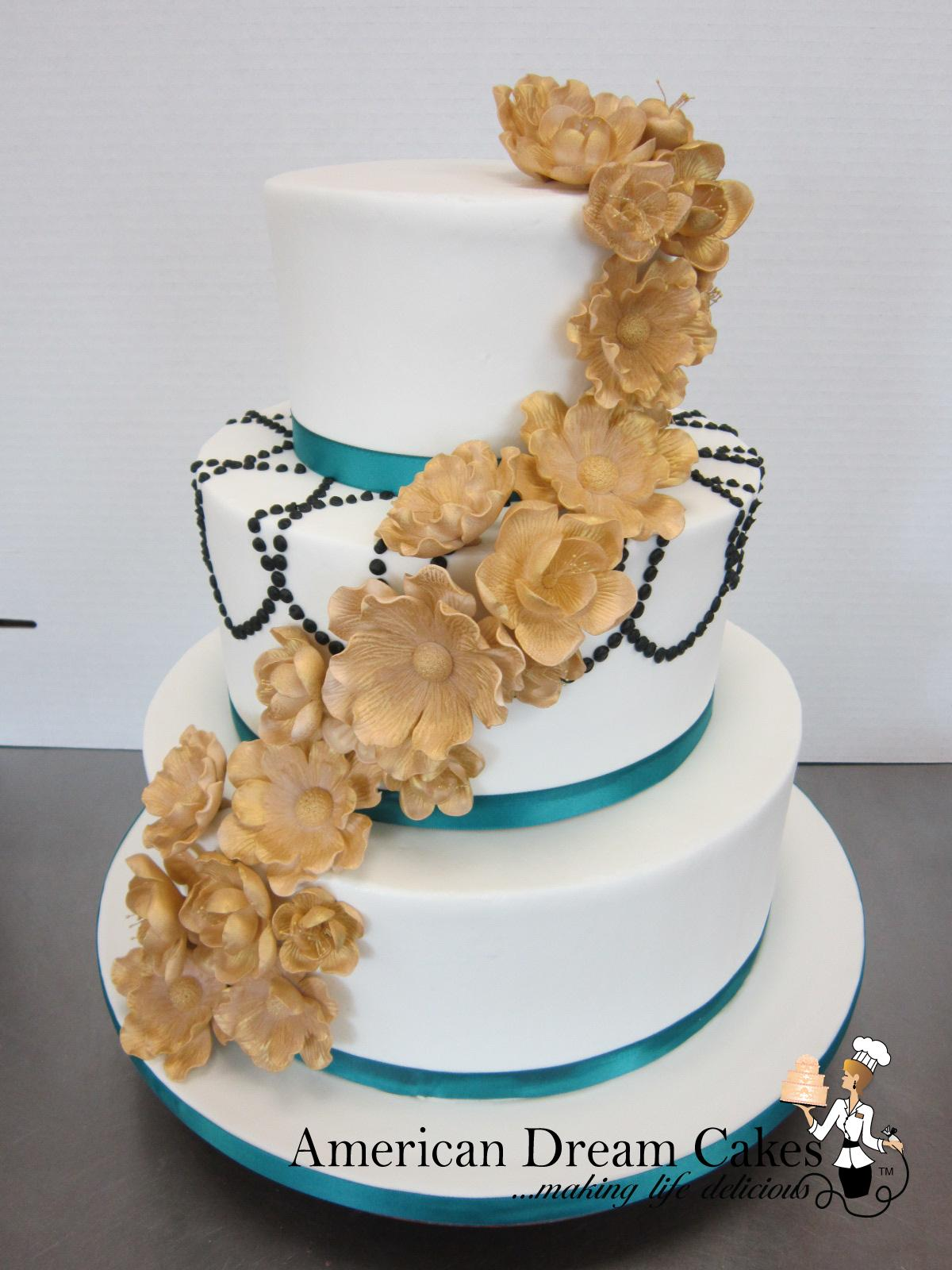 Wedding cake in white, gold and teal