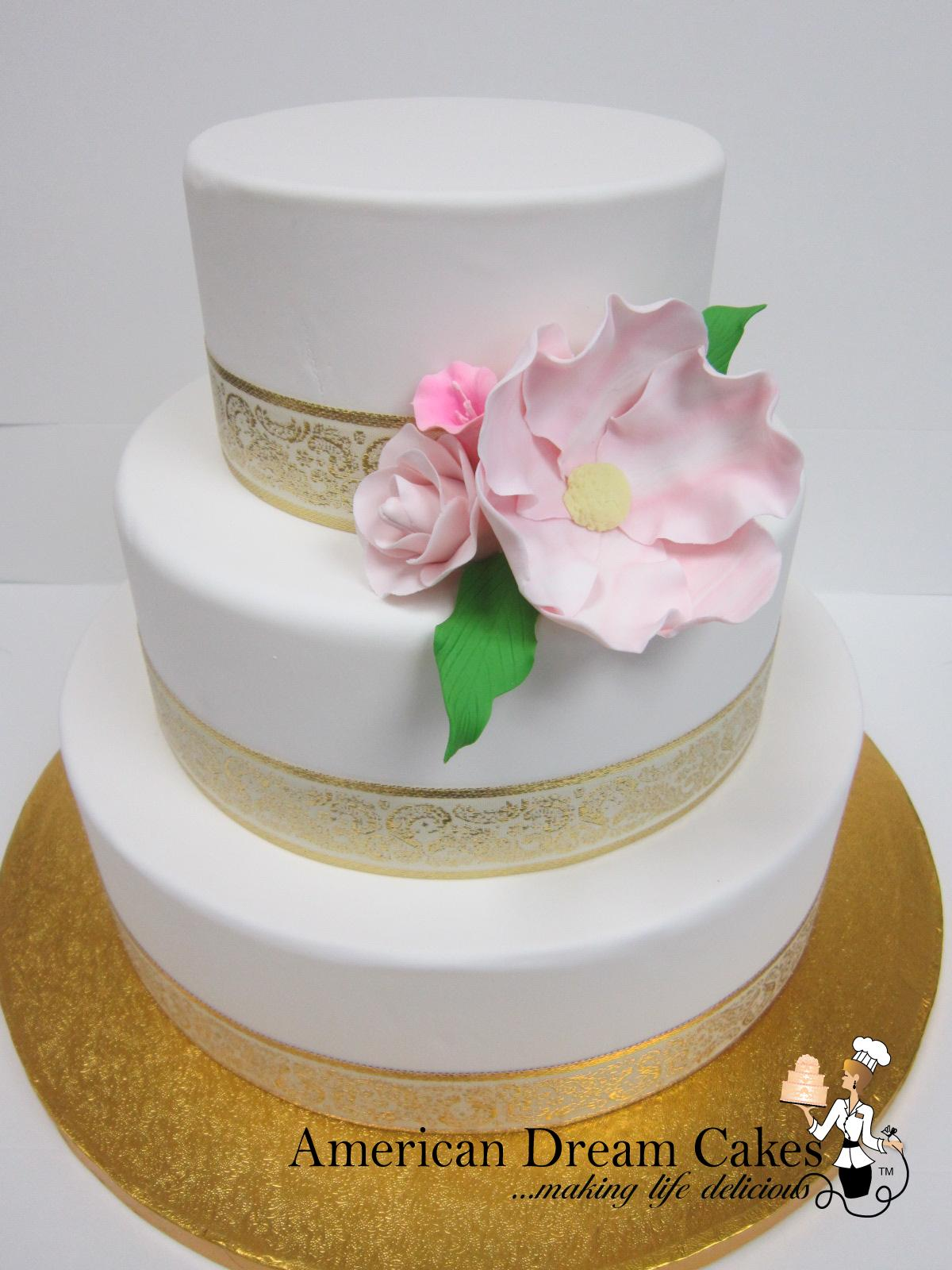 Simple wedding cake in white and gold.